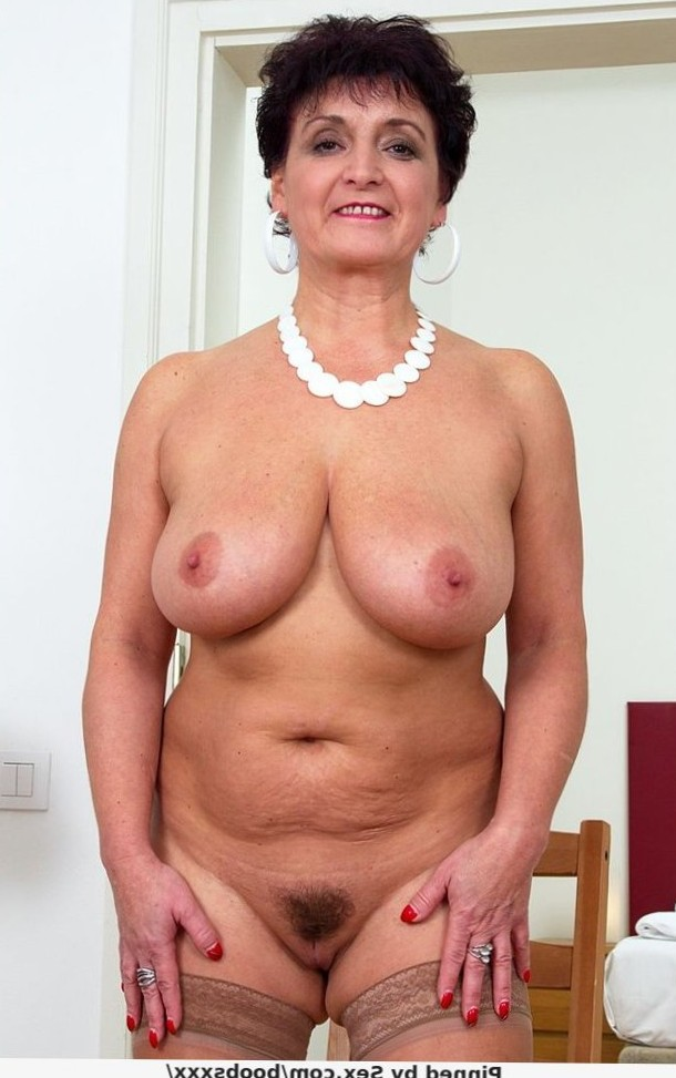Busty mature with hairy pussy