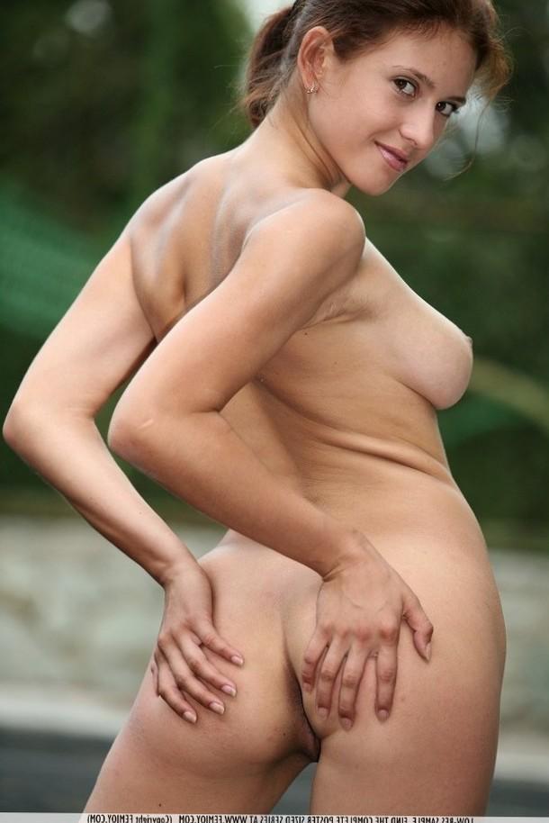 Cute petite brunette spreads her ass