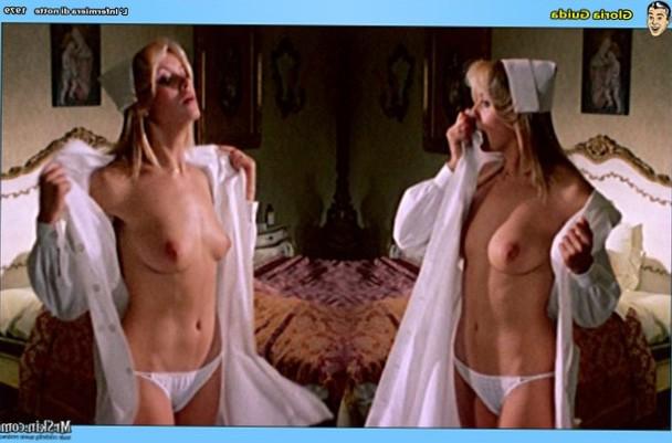 Gloria Guida bares her breasts