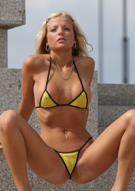 Beach Goddess Squatting in a Tiny Yellow Micro Bikini
