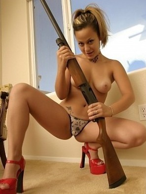 Hot chick with a gun