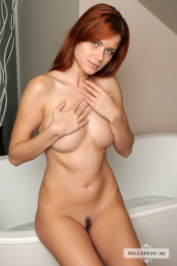 This gorgeous redhead is all a woman needs, great breasts, long red hair and this special kind of innocence.