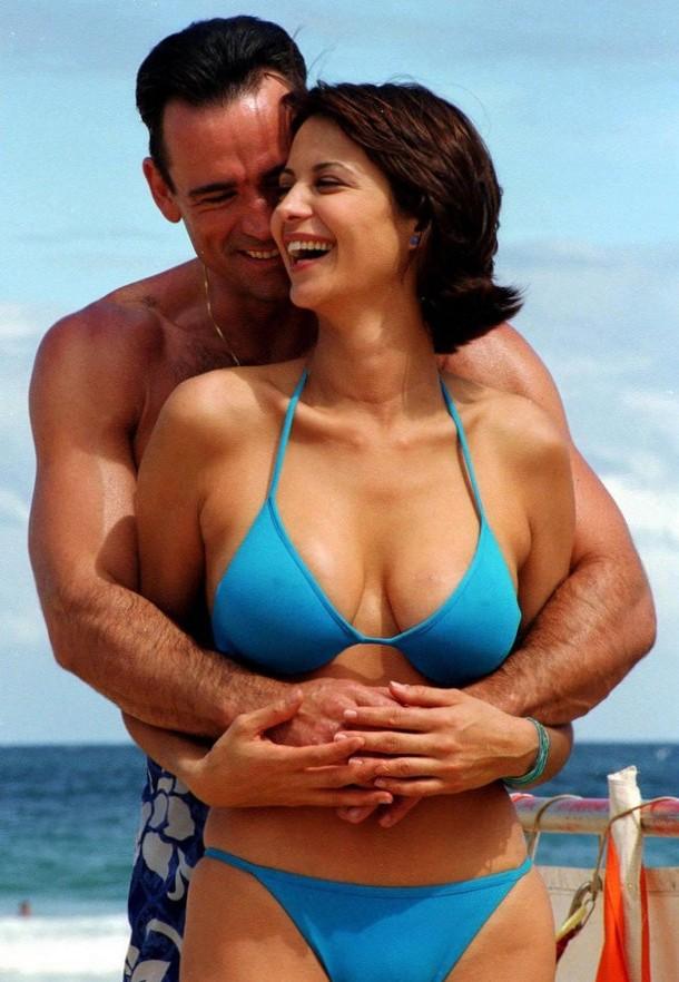 Catherine Bell is hot in a blue bikini